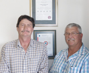 Operations director Frans Labuschagne (left) and Piet Stewart, SHE manager, are full of smiles over their Nosa accolade.